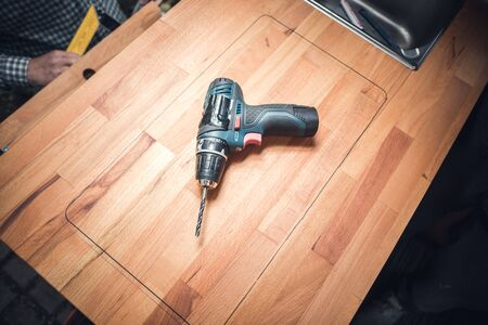 Power drill on a wooden countertop