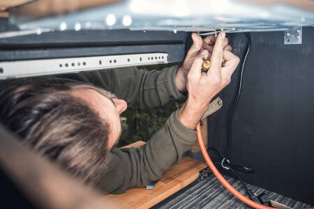 Man installing a gas stove