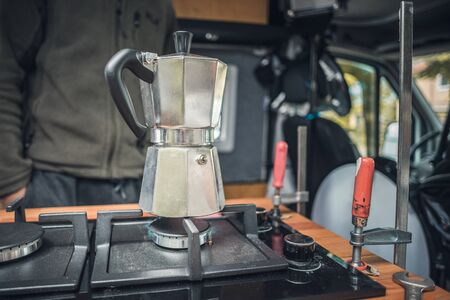 Coffee maker on a newly installed gas stove in a camper van Stock fotó