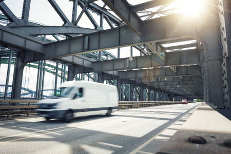 Van driving over an industrial style bridge 版權商用圖片