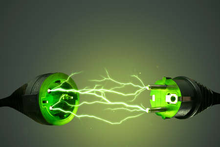 Green energy power plug with electrical lightning Standard-Bild