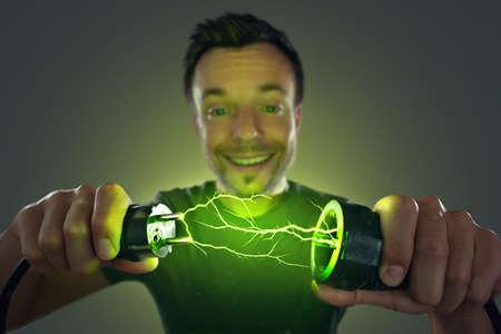 Man connecting green energy power plug