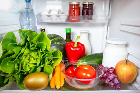 Variety of healthy foods inside a fridge