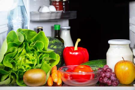 Fresh fruit and vegetable inside a fridge