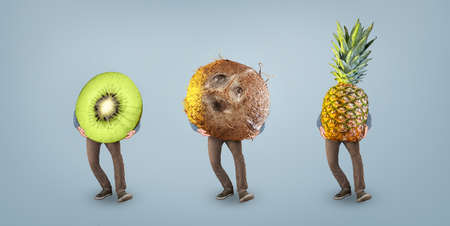 Funny tropical fruits with legs Standard-Bild