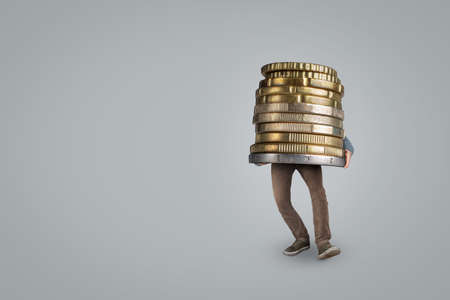 Person bringing a large oversized coin stack