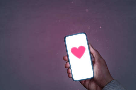 Smartphone screen with a heart symbol