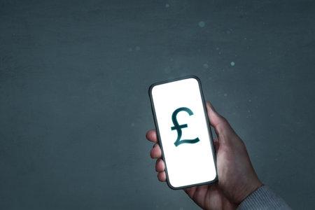 Smartphone screen showing a British pound symbol 版權商用圖片