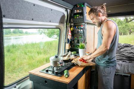 Young man living in a camper van 版權商用圖片