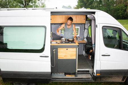 Man living in a DIY camper van