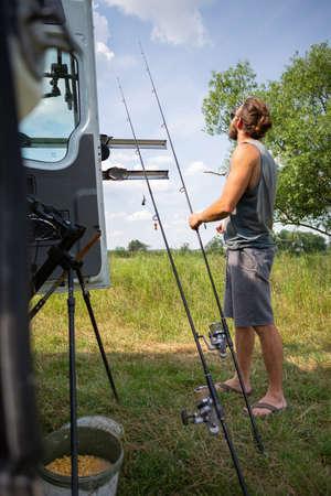 Man preparing carp fishing equipment Reklamní fotografie