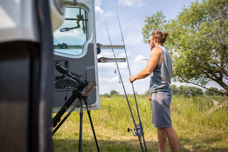 Man preparing fishing rods for carp fishing