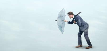 Businessman defying strong headwind