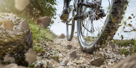 Mountain bike wheel on a gravel track