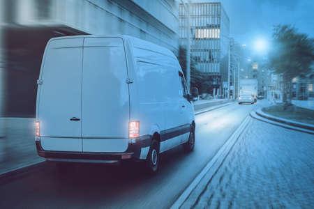 Cargo van driving through a city at night Reklamní fotografie