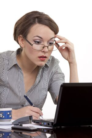 Portrait of a successful young business woman wearing glasses working on a notebook at office Stock Photo - 12402275