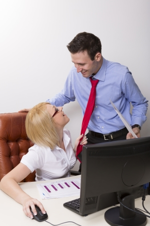 Businesswoman seducing her manager at office photo