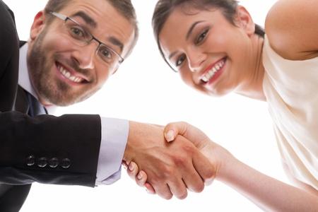 ハッピーと微笑む実業家 ans 実業団ハンド シェーク巧妙な取り引き。
