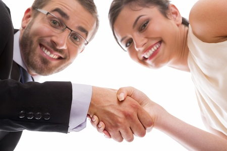 sales person: Happy and smiling businesswoman ans businessman handshaking over successful deal.