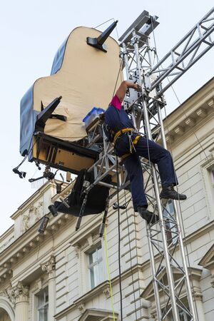 BUCHAREST, ROMANIA - SEPTEMBER 13: Unidentified worker makes final stage adjustments before David Morenos on September 13, 2012 in Bucharest, Romania.
