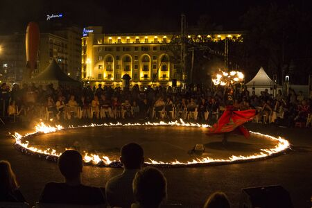 BUCHAREST, ROMANIA - SEPTEMBER 13: Lara Castiglioni performs Neige de Feu show during B-FIT in the Street, International Street Theater Festival on September 13, 2012 in Bucharest, Romania. Editorial
