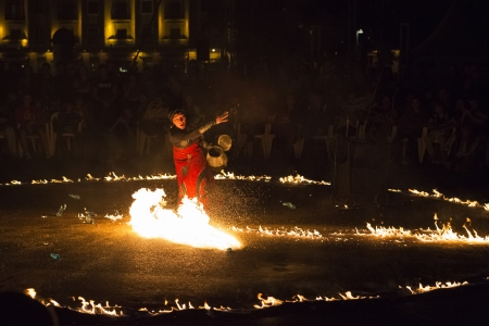 bucharest: BUCHAREST, ROMANIA - SEPTEMBER 13: Lara Castiglioni performs Neige de Feu show during B-FIT in the Street, International Street Theater Festival on September 13, 2012 in Bucharest, Romania. Editorial
