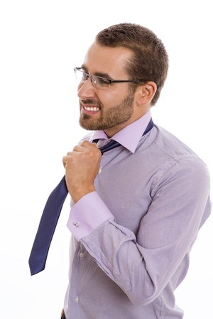 Portrait of anxious businessman loosening his necktie. photo