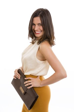 Portrait of confident businesswoman holding brown purse and smiling at you photo