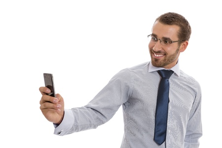 Portrait of cheerful business man with eyeglasses taking photos with phone camera over white background. Stock Photo