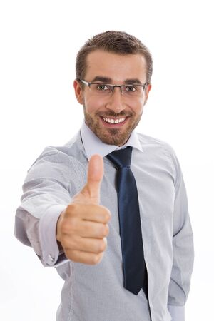 Portrait of happy young businessman smiling and giving the thumb up sign, over white background. photo