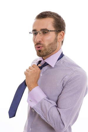 Portrait of businessman showing a relief attitude after loosening his necktie. photo