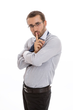 discreet: Secretive business man making silence sign over white background. Stock Photo