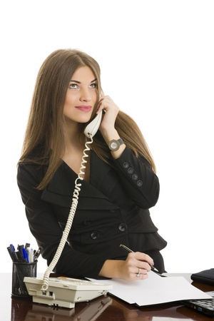 Portrait of beautiful confident young business woman on phone call at office over white background. photo