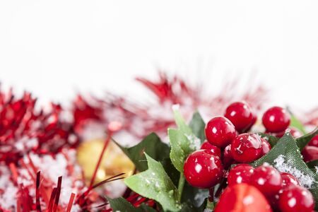 Christmas border with red Holly berries and ribbon covered by snow with copy space  Stock Photo