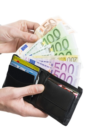Male hands taking out European banknotes from wallet over white background  photo