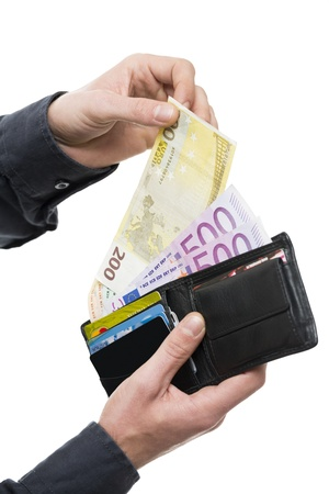 Male hands pulling out 200 Euro from wallet over white background  photo
