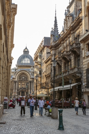 BUCHAREST, ROMANIA - SEPTEMBER 13: Group of tourists stroll down a crowded cobblestone street of the old historical center Lipscani on September 13, 2012 in Bucharest, Romania.