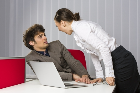 culpable: Furious woman executive yelling at her culpable employee at work. Stock Photo
