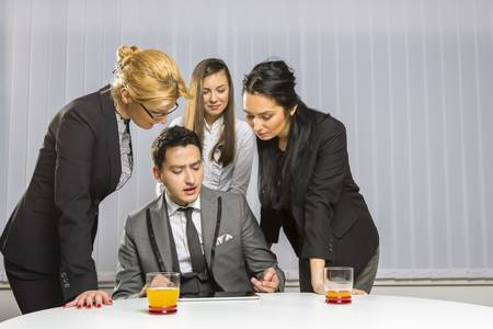Four business partners discussing and planning together during a meeting in office. Stock Photo - 18622796