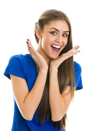 Portrait of a gorgeous young surprised cheerful woman in blue T-shirt over white background. Stock fotó