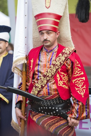 fanfare: BUCHAREST, ROMANIA - MAY 17: Unidentified member of military fanfare Mehter poses in traditional Janissary costume during the celebratory events Turkish Festival on May 17, 2012 in Bucharest, Romania. Editorial