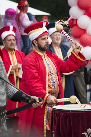 interpreter: BUCHAREST, ROMANIA - MAY 17: Unidentified member of traditional military turkish band performes at drums during the celebratory events Turkish Festival on May 17, 2012 in Bucharest, Romania.