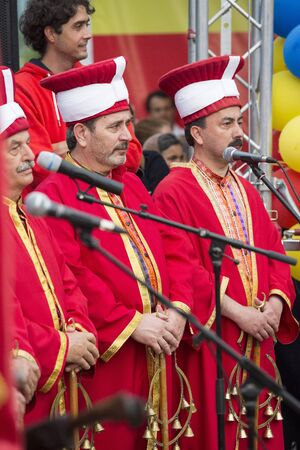 fanfare: BUCHAREST, ROMANIA - MAY 17: Turkish traditional military fanfare Mehter performes live for the audience during the celebratory events Turkish Festival on May 17, 2012 in Bucharest, Romania.