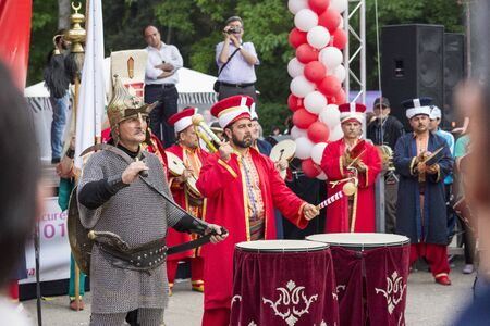 fanfare: BUCHAREST, ROMANIA - MAY 17: Traditional military fanfare Mehter performs a show during the celebratory events Turkish Festival on May 17, 2013 in Bucharest, Romania. Editorial