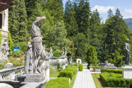 SINAIA, ROMANIA - JULY 24: Peles castle garden with statuary groups on July 24, 2013 in Sinaia, Romania. Peles castle is the most visited museum in Romania with more than 300.000 tourists every year.