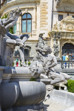 statuary: SINAIA, ROMANIA - JULY 24: Peles castle garden with statuary groups on July 24, 2013 in Sinaia, Romania. Peles castle is the most visited museum in Romania with more than 300.000 tourists every year. Editorial