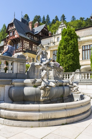 statuary garden: SINAIA, ROMANIA - JULY 24: Peles castle garden with statuary groups on July 24, 2013 in Sinaia, Romania. Peles castle is the most visited museum in Romania with more than 300.000 tourists every year. Editorial