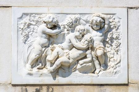 statuary garden: Ornamental allegoric bas-relief sculpture