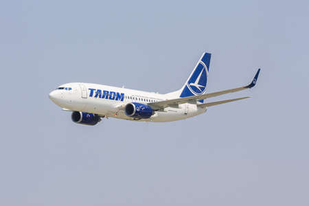 BUCHAREST, ROMANIA - JULY 27  Boeing 737 of TAROM company climbs after take off on July 27, 2013 in Bucharest, Romania  TAROM owns one of the youngest fleet in Europe, consisting of 24 aircrafts
