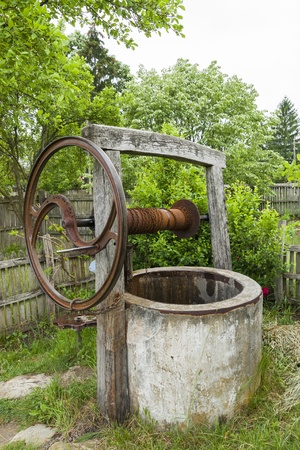draw well: Old abandoned dry rusty draw well  Summer drought  Water crisis  Stock Photo